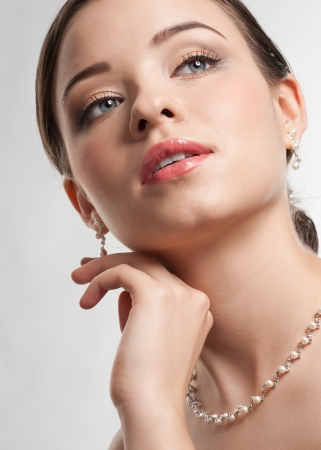 Portrait of lovely woman with beautiful make-up and hairstyle. Elegant woman with pearl jewelry Stock Photo - 12796578