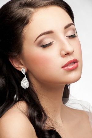 Portrait of beautiful woman with beautiful make-up and hairstyle. Elegant woman with diamond earring Stock Photo - 12797189