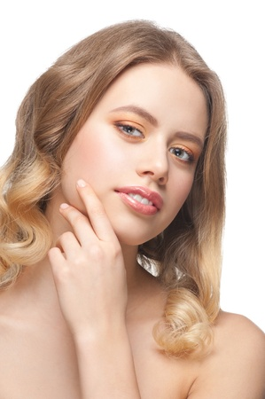 Pretty young woman with beautiful make-up and perfect healthy skin touching her face Stock Photo - 12796727