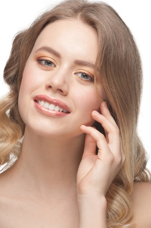 Pretty young woman with beautiful make-up and perfect healthy skin touching her face Stock Photo - 12797300