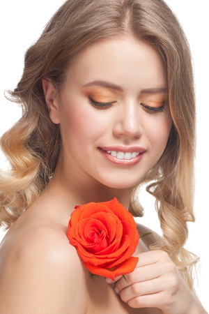 Pretty young woman with beautiful make-up and perfect healthy skin with rose in her hand Stock Photo - 12795979