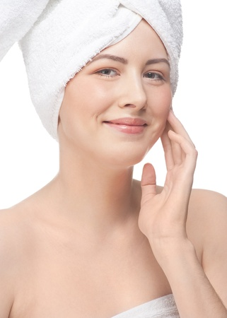 Portrait of young beautiful woman applying moisturizing cream on her face, isolated on white background Stock Photo - 12796268