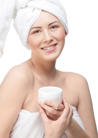 Young beautiful woman with jar of moisturizing cream for face or body, isolated on white background Stock Photo - 12794963