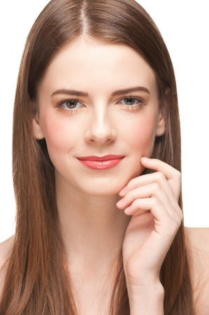 Pretty young woman with beautiful make-up and perfect healthy skin touching her face. Isolated on white background Stock Photo - 12797185