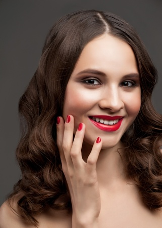 Portrait of young beautiful woman with stylish makeup, hairstyle and red manicure Stock Photo - 12797175