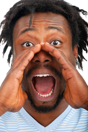 Closeup portrait of a young african american man screaming out loud, isolated on a white background photo
