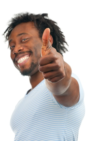 Portrait of young african-american man showing thumb up and smiling, over white background photo