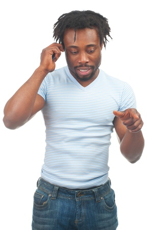 Portrait of young african-american man talking on the mobile phone, over white background photo