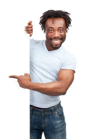 Cheerful young african american man with blank signboard pointing, isolated on white background photo