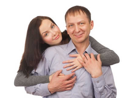 Happy young couple hugging, isolated on white background Stock Photo - 12794954