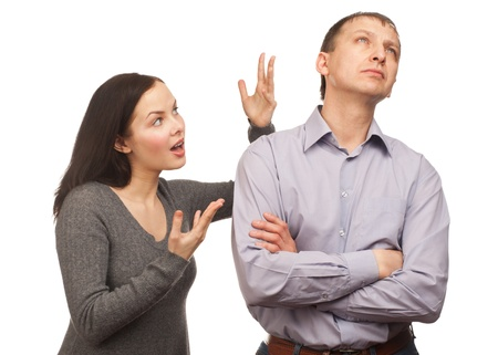 Young couple in quarrel. Wife yelling at her husband, isolated on white background photo