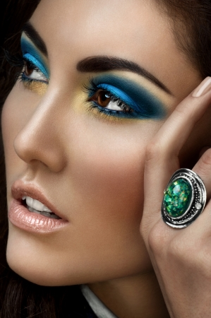 Closeup portrait of young beautiful woman with bright fashion makeup photo