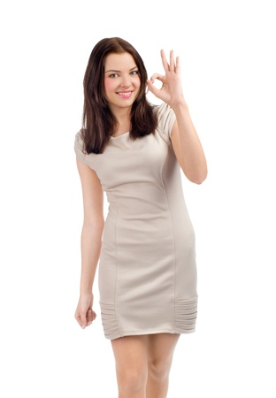 Portrait of happy beautiful woman showing ok sign and smiling, over white background Stock Photo - 13301698