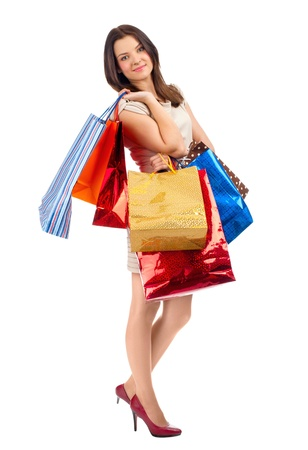 shopaholics: Full length portrait of pretty young woman with colorful shopping bags. Isolated on white background