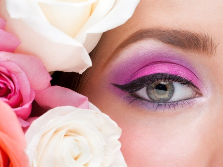 Close-up of woman eye with bright stylish makeup and pink roses Stock Photo - 13322370