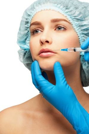 Cosmetic injection of botox to woman face, to the lips. Isolated on white background Stock Photo - 13323195