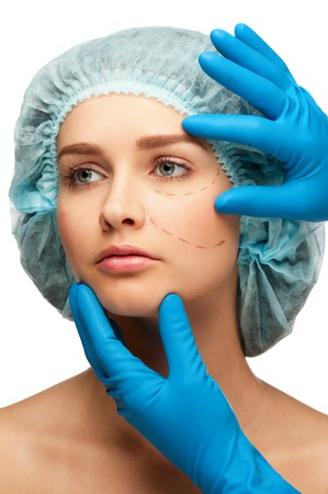 Woman face with perforation lines before plastic surgery operation. Isolated on white background photo