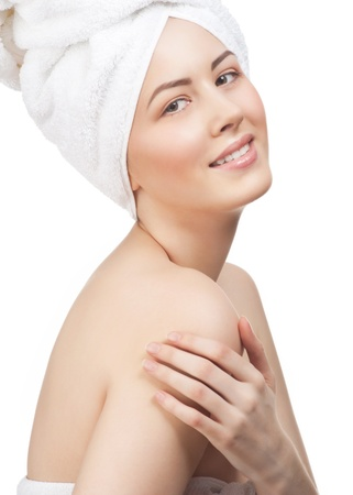 Portrait of young beautiful woman in white towel with healthy skin, isolated on white background photo