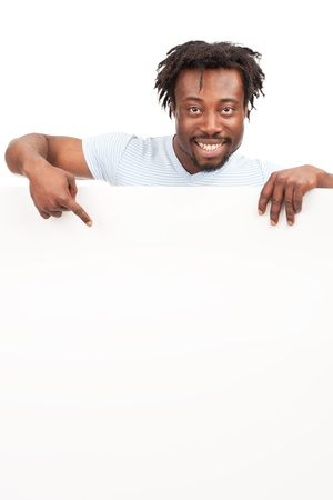 Cheerful young african american man with blank billboard pointing, isolated on white background photo
