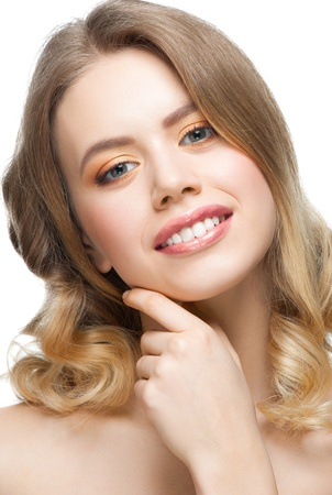 Pretty young woman with perfect healthy skin touching her face Stock Photo - 13644989