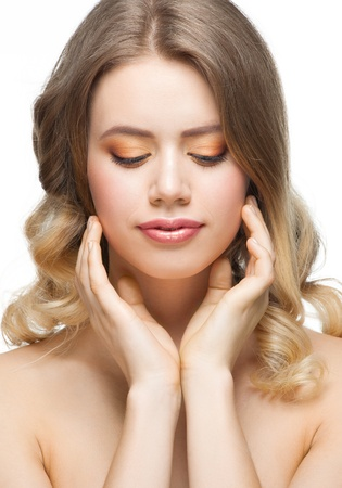 Pretty young woman with perfect healthy skin touching her face Stock Photo - 13645005