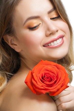 Pretty young woman with beautiful fresh make-up and perfect healthy skin with rose  photo