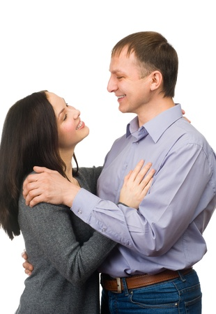 looking around: Happy young couple hugging, isolated on white background