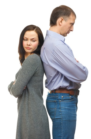 relationship problems: Couple having relationship difficulties, standing back to back. Isolated on white background