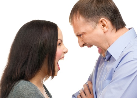 Couple in quarrel. Wife yelling at her husband, isolated on white background photo