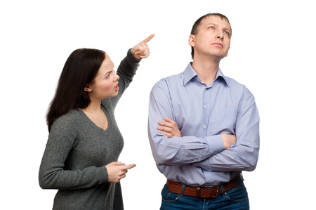Couple in quarrel. Wife scolding her husband, isolated on white background photo