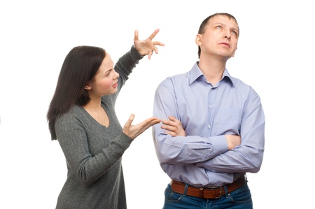impatience: Couple in quarrel. Wife scolding her husband, isolated on white background