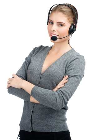 Portrait of female call center employee with crossed arms wearing a headset, against white background photo