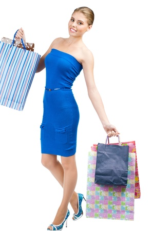 Full length portrait of pretty young woman with colorful shopping bags. Isolated on white background Stock Photo - 14025049