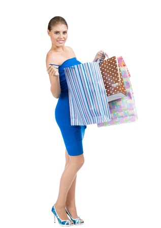 Full length portrait of pretty young woman with colorful shopping bags. Isolated on white background Stock Photo - 14025022