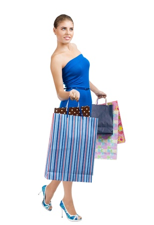 Full length portrait of pretty young woman with colorful shopping bags. Isolated on white background photo
