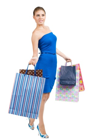 Full length portrait of pretty young woman with colorful shopping bags. Isolated on white background Stock Photo - 14025058