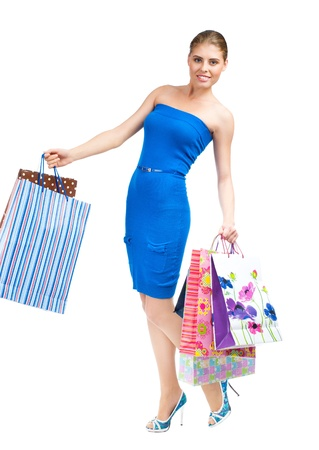 Full length portrait of pretty young woman with colorful shopping bags. Isolated on white background Stock Photo - 14025026