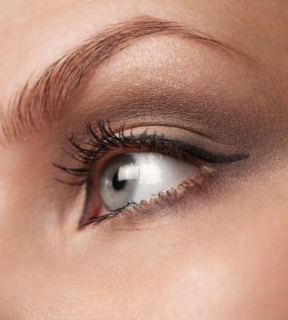 Close-up shot of woman eye with makeup looking away photo