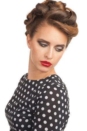 Portrait of beautiful young sensual woman with vintage make-up and hairstyle. Woman with red lipstick. Stock Photo - 14843440