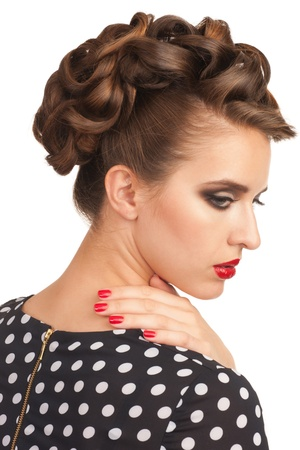 Portrait of beautiful young sensual woman with vintage make-up and hairstyle. Woman with red lipstick. photo
