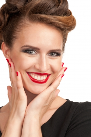 Portrait of beautiful woman with vintage make-up and hairstyle looking surprised photo