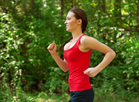 Young beautiful athlete woman jogging outdoors in park  Stock Photo