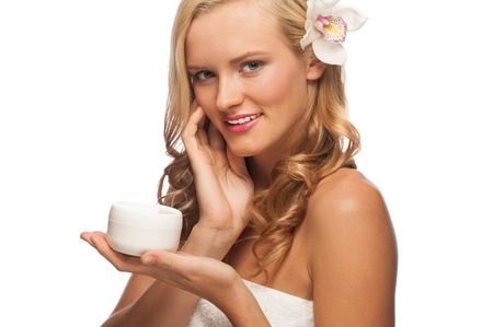 Portrait of young beautiful caucasian woman applying moisturizing cream  Isolated on white background photo
