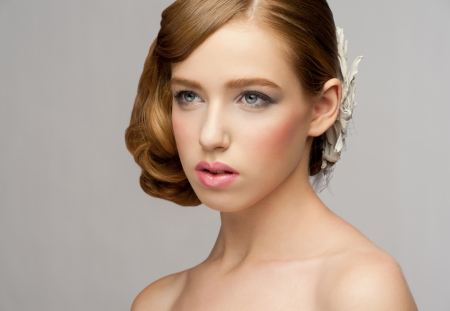 Portrait of attractive young woman with makeup and  beautiful hairstyle photo