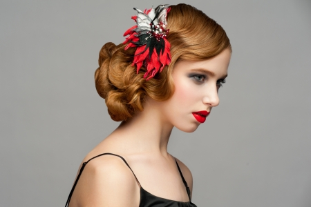 Portrait of attractive young woman with red lipstick and  beautiful hairstyle. Hairdo with beautiful hair decoration photo