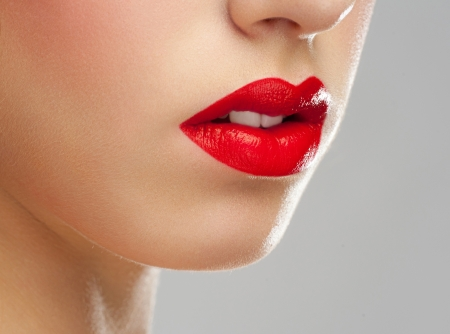 Close-up shot of sexy woman lips with red lipstick  photo