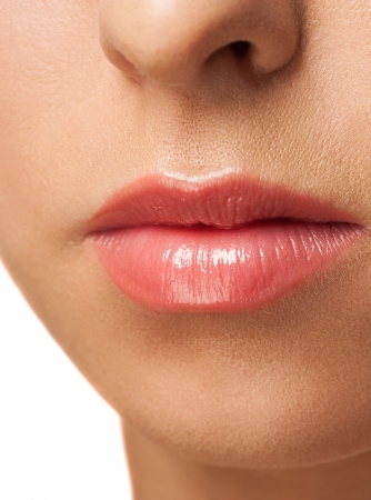 Close-up shot of woman lips with light pink  lipstick  photo