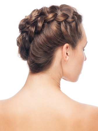 Portrait of young beautiful woman with creative braid hairdo. Rear view, isolated on white background photo