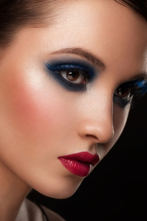 Portrait of attractive young woman with bright creative makeup photo