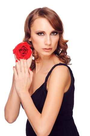 Portrait of young beautiful woman with red rose and stylish bright makeup. Isolated on white background photo